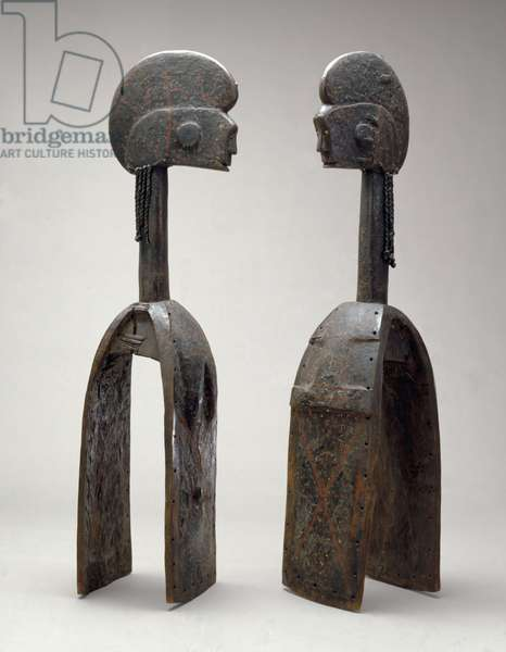 Male and female Waja masks, from Upper Benue River, Nigeria, 1850-1950 (wood, ochre & brass tacks)