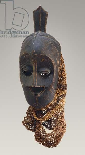 Mask, 19th-20th century (wood, pigment & fiber netting)