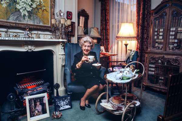 Dame Cicely Courtneidge taking tea at home, 1973 (photo)