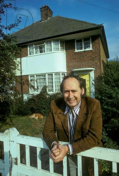 J. G. Ballard, outside his home in Shepperton, 1973 (photo)