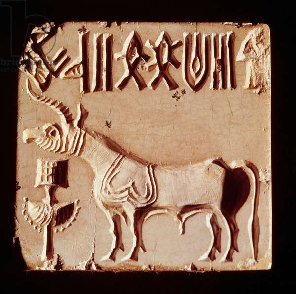 Seal depicting a mythological animal and pictographic symbols, from Mohenjo-Daro, Indus Valley, Pakistan, 3000-1500 BC (stone)