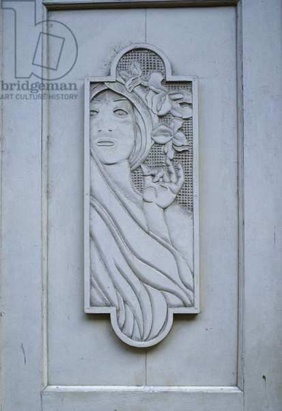 Carved ornamental panel, in the old financial district on Obispo, early 1900s (photo)