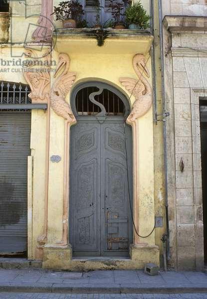 Grey door with Art Nouveau surround, off Plaza Vieja, built c.1900 (photo)