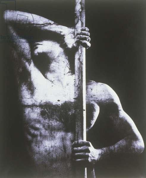 Semi dress man holding stick