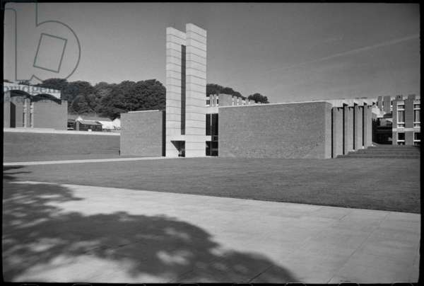 The front elevation of the Arts building at the University of Sussex, built by Sir Basil Spence between 1962-66, seen from the south-east and showing the concrete tower with two rectangular piers linked near the bottom to form a low 'H' shape, c.1955-c.1980 (b/w photo)