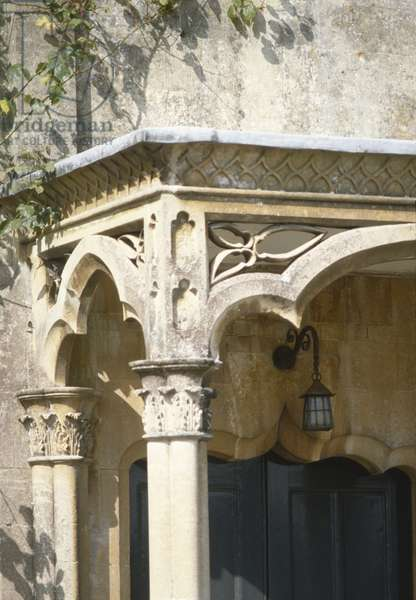 Detail of porch showing slender columns supporting cusped arches (photo)