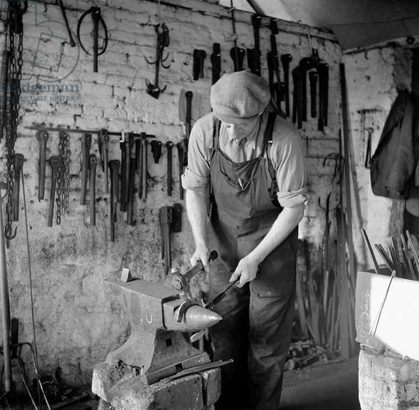 Blacksmith, Woodbastwick, Norfolk, February 1949 (b/w photo)