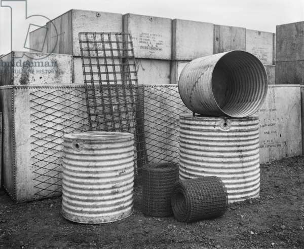 Stockpiled water tanks in Canning Town, 1919 (b/w photo)