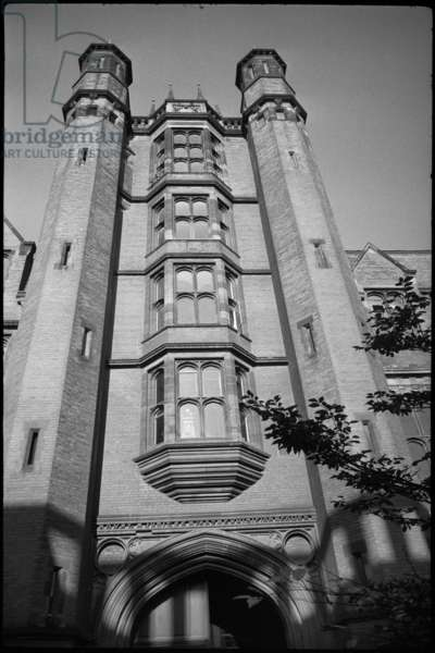 A detailed view of the south-east elevation of the Armstrong Building on Queen Victoria Road,showing the five story Tudor style gatehouse with oriel windows and octagonal towers, c.1950-c.1980 (b/w photo)