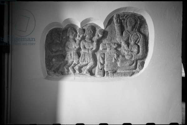 Detail of a relief of the Adoration of the Magi, most likely 12th century, with thick rendering surrounding it, in St Gregory the Great's Church, c.1955-c.1980 (b/w photo)