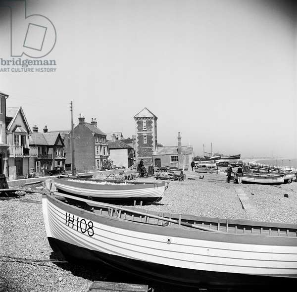 View showing boats on the shore looking towards Aldeburgh lifeboat station, 1950 (b/w photo)