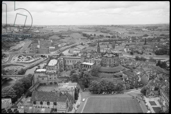 A general view of Durham, seen from the top of the Cathedral, showing Palace Green, Durham Castle, Market Place with St Nicholas' Church and the River Wear with Milburngate House in the background, c.1955-c.1980 (b/w photo)