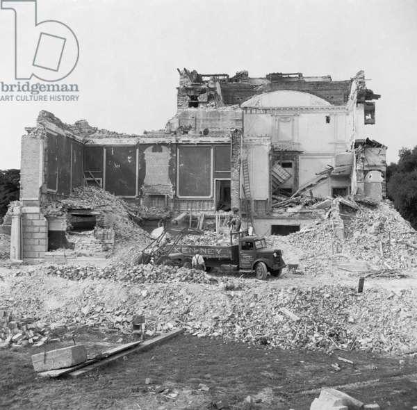 General view of Henham Hall, Suffolk, showing demolition in progress, 9 July 1953 (b/w photo)