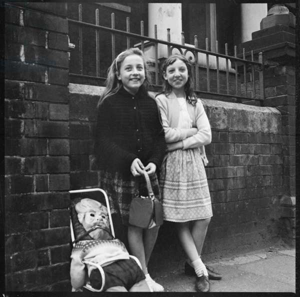 Two girls standing in front of Hill Top Methodist Church (Burslem Sunday School) collecting a 'Penny for the Guy', Hill Top Methodist Church, Westport Road, Burslem, Stoke-On-Trent, City Of Stoke-On-Trent, UK, 1965-68 (b/w photo)