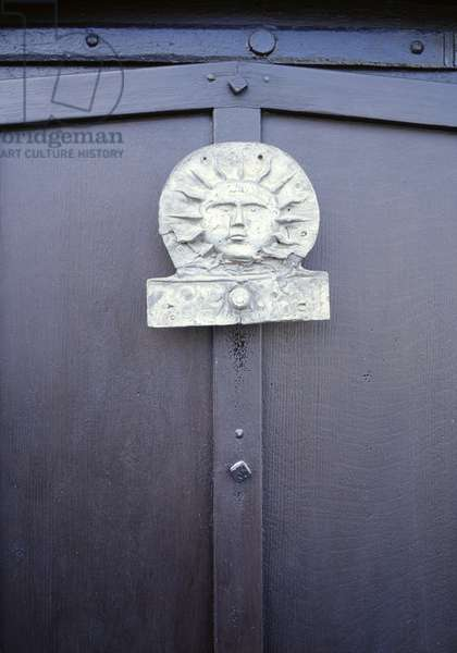 Old insurance plaque or Fire mark fixed onto door (photo)