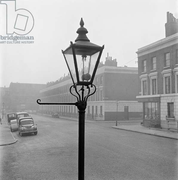 Dame Street, Islington, London: showing the top of a lamp post in the foreground, and terraced houses beyond, 1955-65 (b/w photo)