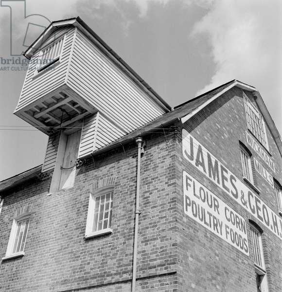 Exterior view of Wickham Mills showing detail of the hoisting machinery c.1956, Maldon, Essex, UK (b/w photo)