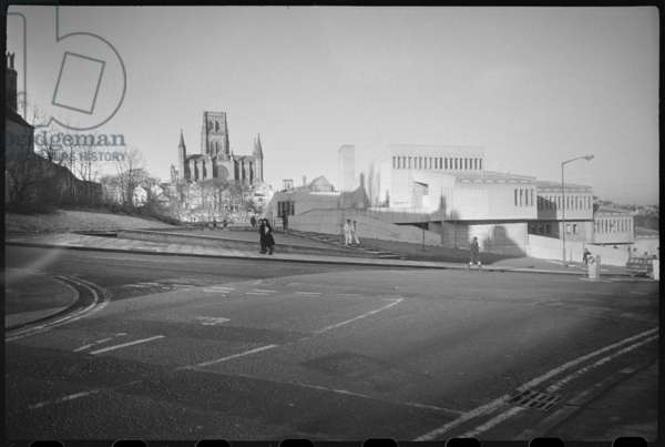 An exterior view of Dunelm House, showing the east elevation, with a the east front of Durham Cathedral in the background, Dunelm House, New Elvet, Durham, County Durham, UK, c.1966-80 (b/w photo)