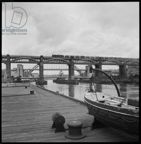 A general view of the River Tyne, seen from the north bank and looking east, with the High Level Bridge in the foreground, Swing Bridge in the midground and Tyne Bridge in the background, c.1955-c.1980 (b/w photo)