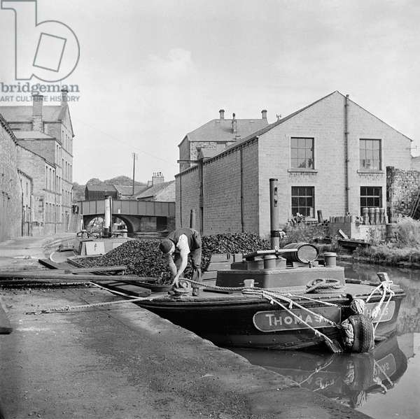 General view showing barges moored on the Leeds Liverpool Canal, 1947 (b/w photo)