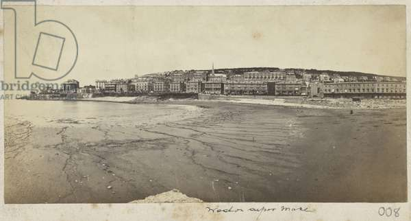 The seafront at Weston-super-Mare viewed across Glentworth Bay from Knightstone Island showing Claremont Crescent under construction, 1865-67 (b/w photo)