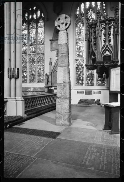 A detailed view of an Anglo-Saxon Cross, situated underneath an arch at the eastern end of the south arcade of St Peter's Parish Church, c.1955-c.1980 (b/w photo)