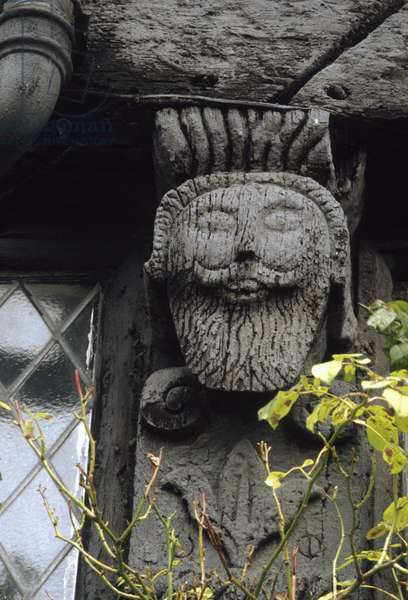 Detail of carved wooden caryatid figure on half-timbering, Corve Street, early 17th century (photo)
