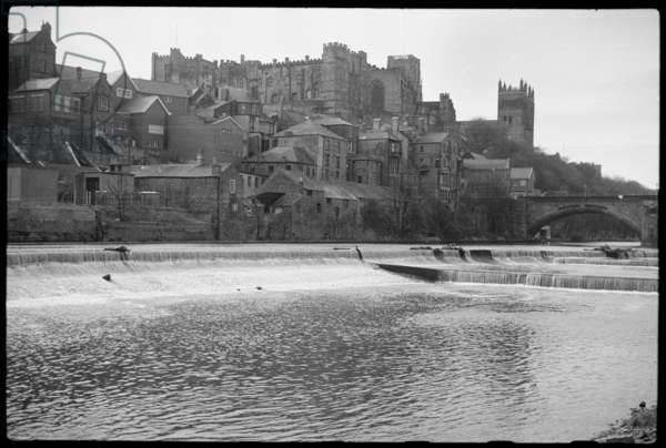 A general view of Durham Castle and Cathedral, seen from the west bank of the River Wear, north of Framwelgate Bridge, Durham Castle, Durham, County Durham, UK, c.1955-80 (b/w photo)