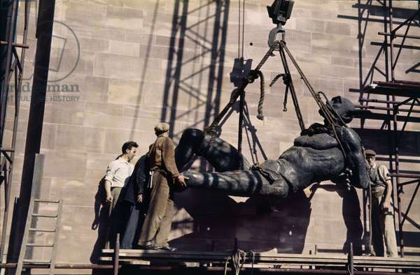 Jacob Epstein's sculpture of the devil being hoisted into position, St Michael's Cathedral, Coventry, UK, 1961-62 (photo)