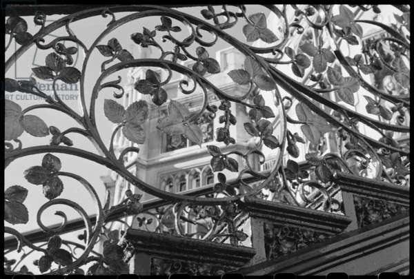 A detailed view of an exterior staircase in the garden of Strawberry Hill House, showing the wrought iron vine and leaf patterned panel underneath the balustrade, Strawberry Hill, Waldegrave Road, Strawberry Hill, Richmond Upon Thames, Greater London Authority, UK, c.1955-80 (b/w photo)
