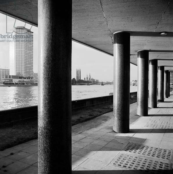 Looking across the Thames from the Albert Embankment towards Vickers Tower, now known as Millbank Tower, with the supporting columns of the pilotis of Alembic House in the foreground, 1963-69 (b/w photo)