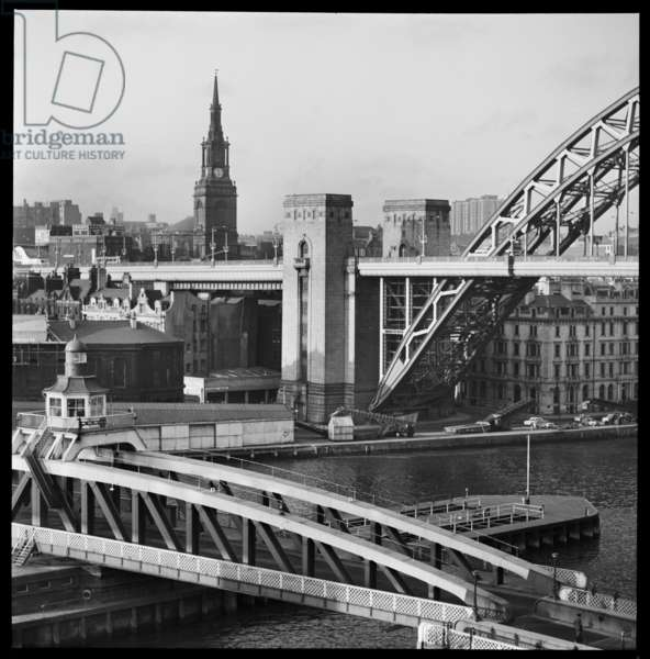 A general view, taken from an elevation position on the south bank of the River Tyne and showing the Swing Bridge, Tyne Bridge and All Saints Church, c.1955-c.1980 (b/w photo)