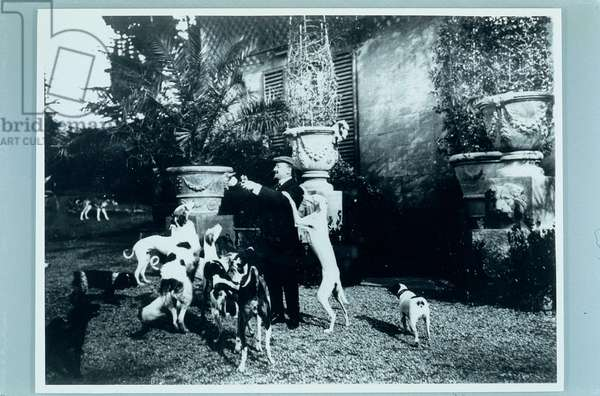 "Gabriele d'Annunzio and its Dogs in the Garden of Capponcina"" on the Hill of Settignano"", (photograph b/w)"