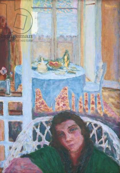 Lighting Interior or Interior with Woman in a Wicker Chair (Intèrieur clair ou Intèrieur avec une femme dans un fauteuil d'osier), by Pierre Bonnard, 1920, 20th Century, oil on canvas, 72 x 51 cm