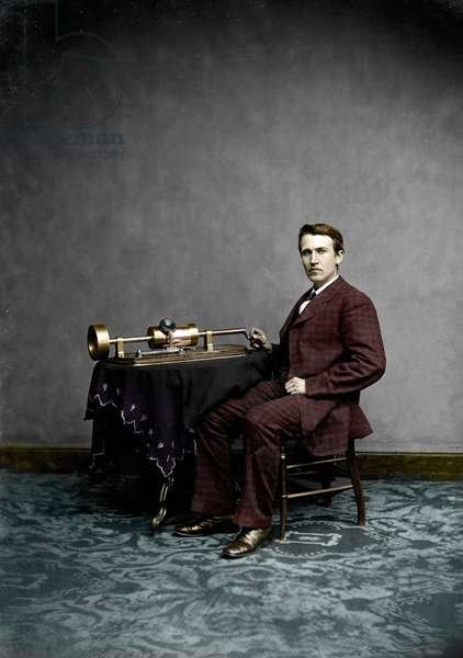 American scientific and industrial inventor Thomas Edison (1847-1931) posing with his cylinder phonograph, April 1878 (photo)