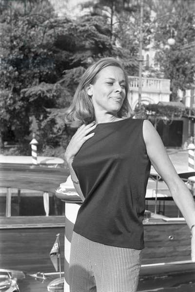 English actress Honor Blackman posing for the photographers, Lido, venice, 1965 : At The Movie Festival