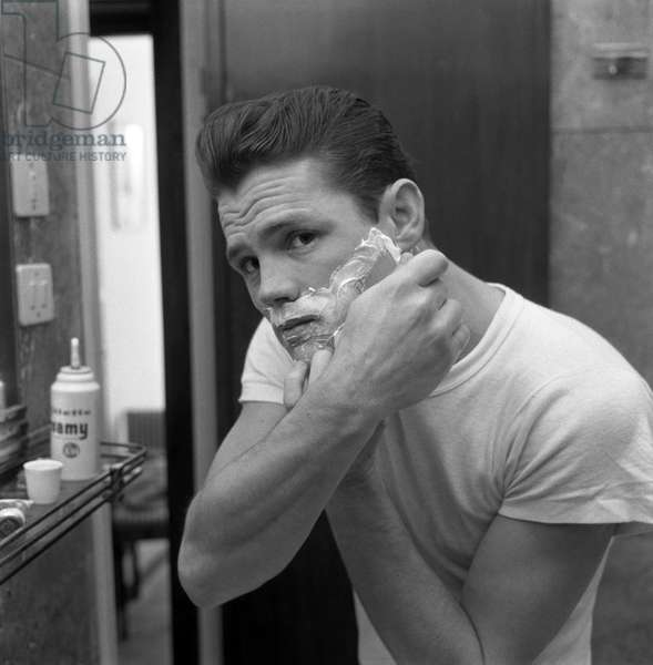 American jazz musician Chet Baker, reflected in a mirror while shaving, shaving foam on his face, Lucca 1961 ©Archivio Cameraphoto/leemage