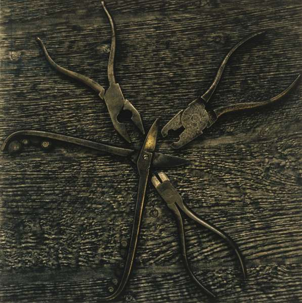 Pincers and pliers on wooden background