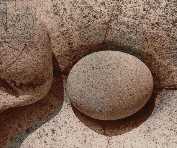Round Stone on Rock