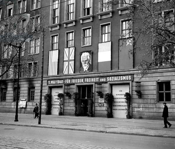 Blockade of Berlin by english - Blockade of Berlin (1948-1949): Berlin (Germany) 1 May 1948. On Labour Day, on the Potsdamer Strasse, the Railways building near the headquarters of the Allied Control Authority bulwarks with the four flags of the occupying powers and adorns the portrait of Theodor Leipart, German trade unionist from the interwar