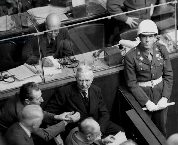 Second World War (1939-1945) - World War II (WWII or WW2): Nuremberg (Germany) February 7, 1946: At a hearing of the International Tribunal (IMT) charged with trying the main Nazi officials, Hans Fritzsche (1900-1953) (left) discussed with Hjalmar Schacht (1877-1970) (centre)