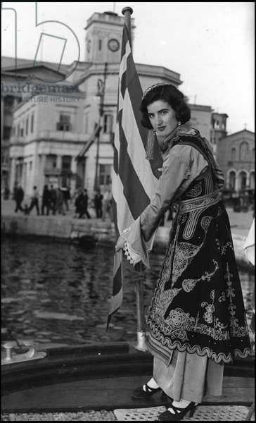 Marshall Plan (ERP) (1948-1952): a young Greek woman during the baptism of the Marshall Plan exhibition aboard the SS Samuel Howe. The Piree, Greece, 1951 photograph.