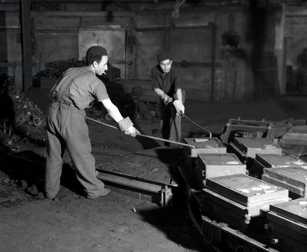 Plan Marshall or European Recovery Program (ERP) (1948-1952): two North African workers working at the Japy Foundry in Beaucourt (Territoire de Belfort). Photography March 1951.
