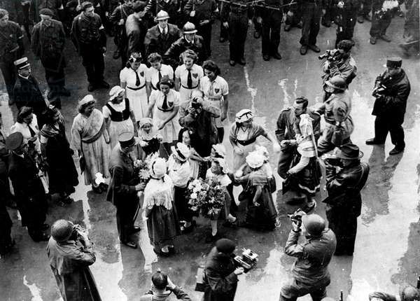 Second World War (1939-1945) - World War II (WWII or WW2): Nancy (Meurthe and Moselle) France 25 September 1944: General De Gaulle (President of CFLM) is greeted by young girls in regional costume upon arrival at the Hotel de Ville