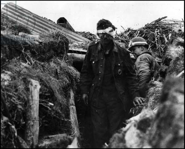 Debarking in Normandy on June 6, 1944 (D Day or D Day): a German gunner comes out of his shelter under the eye of an American MP on the beach of Utah Beach. Photograph of June 6, 1944.