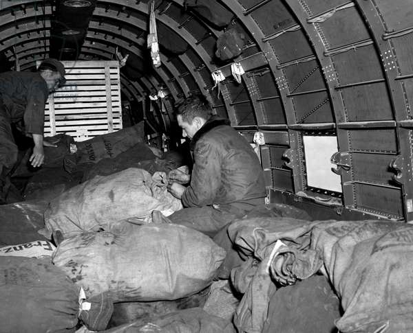 Blockade of Berlin by russian - Blockade of Berlin (1948-1949): USAF Rhein-Main Airport (near Frankfurt) Germany 9 July 1948. During the blockade of the former German capital by the Sovietic authorities and Operation Vittles (Victuailles), two GIs of a C47 label the bags of three tons of mail that have just been loaded by volunteer German workers and will be transported to Berlin. This blockade will last from 24 June 1948 to 12 May 1949