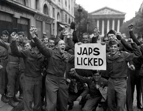 Second World War (1939-1945) - World War II (WWII or WW2): Paris (France) August 10, 1945: On the unofficial announcement of Japan's unconditional surrender, these American soldiers celebrating this news blocked traffic on Rue Royale
