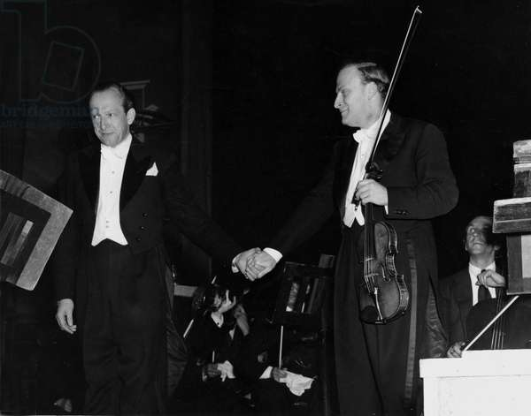 Second World War (1939-1945) - World War II (WWII or WW2): Berlin (Germany) 1st July 1948: After a concert at the Palast, the famous violinist Yehudi Menuhin shares the applause with German conductor Ludwig Leopold. This is the second time that Yehudi Menuhin has given a concert in Germany since the end of the war.