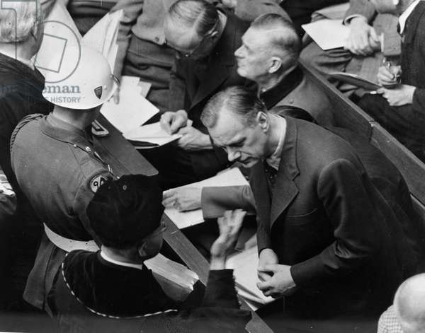 World War II (WWII) (1939-1945) - World War II (WWII or WW2): Nuremberg (Germany) 1946: During a suspension of the hearing of the International Tribunal (IMT) to try the main Nazi officials, Dr. Alfred Thema (in dress) talks with his client Alfred Rosenberg