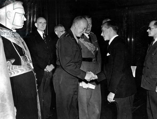 Second World War (1939-1945) - World War II (WWII or WW2): Brussels, Belgium 9 November 1944: General Dwight Eisenhower (Supreme Commander of the Allied Forces in Europe) meets Belgian personalities. On the left, Cardinal Van Roey (Archeveque of Belgium) and in the centre Prince Charles of Belgium (brother of King Leopold III)